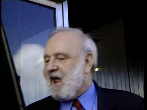 prospective candidate frank dobson mp from building and speaking to press sot i represent the real labour party dobson along track millbank tower pan... - 表す点の映像素材/bロール