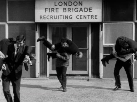 prospective firemen are tested by carrying men at the london fire brigade recruiting centre - brigade stock videos & royalty-free footage
