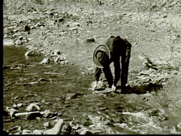 1924 b/w ws prospector panning for gold in stream / south dakota, usa - panning stock videos & royalty-free footage