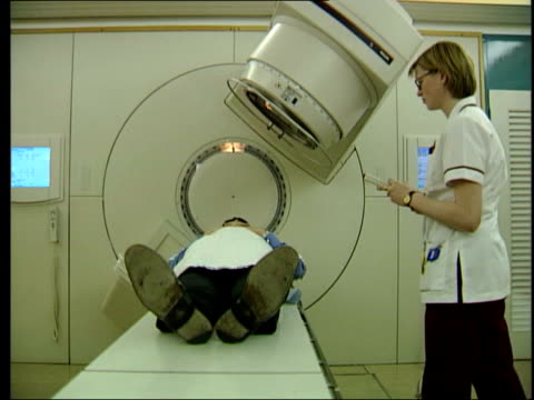 new research lib man laying on table before undergoing scan patient being scanned - prostate stock videos and b-roll footage
