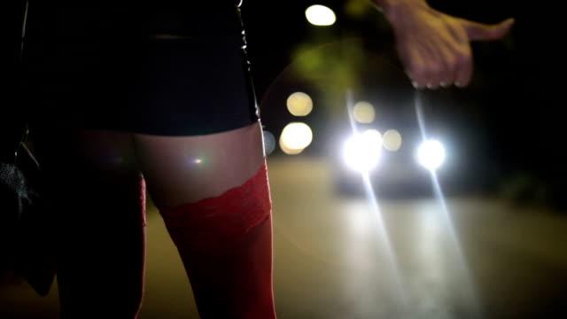 prostitute hitchhiking - minigonna video stock e b–roll