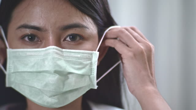 protect and care - surgical mask stock videos & royalty-free footage