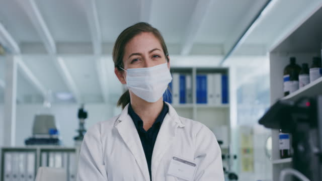protect yourself before you perform any experiments - lab coat stock videos & royalty-free footage