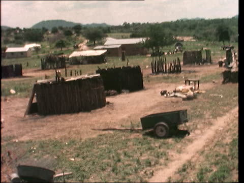 Protected village set alight by guerillas RHODESIA North East Kandaya GV Burnt out village MS Ditto MS Burnt stumps Pull Out Village CS Charred wood...