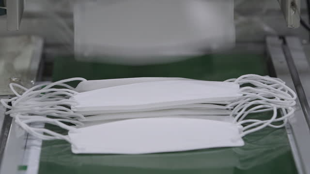 protective face mask being manufactured in factory - group of objects stock videos & royalty-free footage