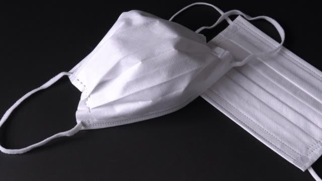 skyddsmasker | ansiktsmask - slit och släng bildbanksvideor och videomaterial från bakom kulisserna