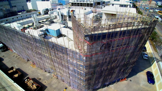 WS AERIAL POV Protective sheeting and bamboo scaffolding on building / Hong Kong, China