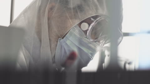 protective workwear : virus vaccine - overworked stock videos & royalty-free footage