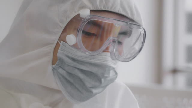 protective workwear : virus vaccine - employment issues stock videos & royalty-free footage