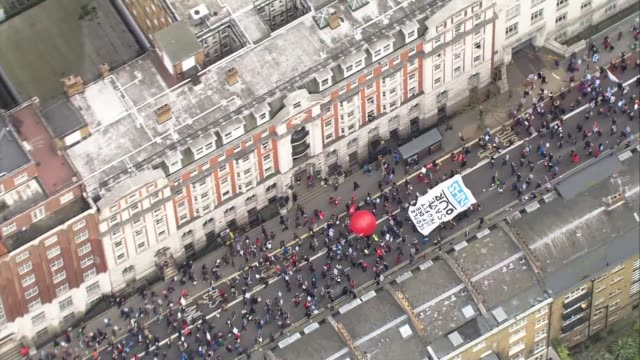 nhs protest aerials air views / aerials protesters along through bedford square and down bloomsbury street past shaftesbury theatre / large banner... - charing cross stock videos and b-roll footage