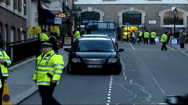 Protest against former Iranian President's visit to Great Britain General view of police officers in fluorescent vests standing in street / More of...