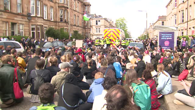 protest against immigration officers in glasgow as two indian nationals were detained in a van by immigration officers - domestic room stock videos & royalty-free footage