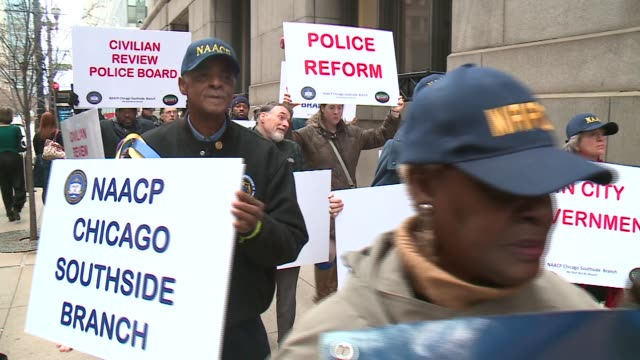 protest against police brutality and the release on bond of officer jason van dyke at chicago city hall on november 30 2015 in chicago illinois - naacp stock videos & royalty-free footage