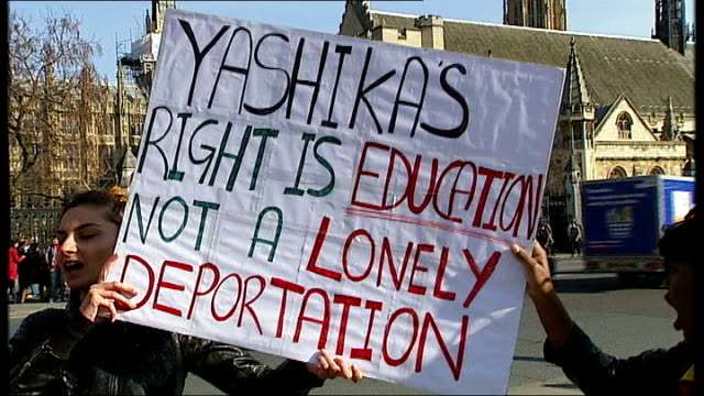 vídeos y material grabado en eventos de stock de protest against teenager's deportation back to mauritius england london westminster ext student friends of yashika bageerathi chanting at protest... - placard