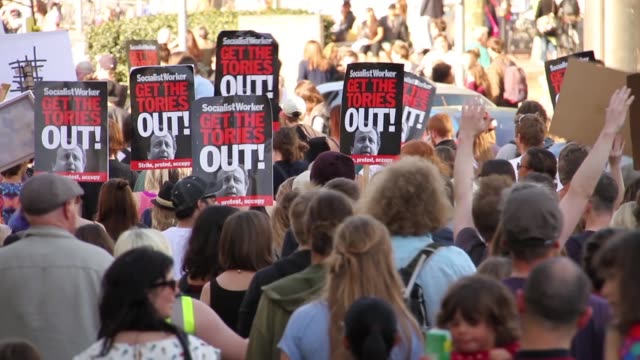 protest against the new conservative government, public spending cuts and austerity, in bristol uk, may 13th, after the 2015 general election - イングランド南西部点の映像素材/bロール
