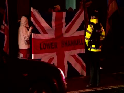 protest at night in belfast over the limiting of days on which the union flag can fly over belfast city hall, northern ireland - rathaus stock-videos und b-roll-filmmaterial