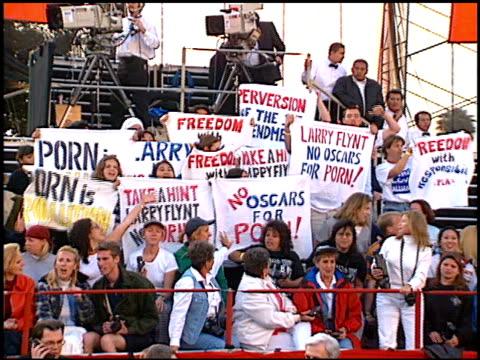 protest at the 1997 academy awards arrivals at the shrine auditorium in los angeles, california on march 24, 1997. - oscarsgalan 1997 bildbanksvideor och videomaterial från bakom kulisserna