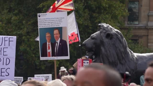 a protest banner showing bill gates and matt hancock demonstrators attend a we do not consent antimask rally at trafalgar square on september 26 2020... - {{ collectponotification.cta }} stock videos & royalty-free footage