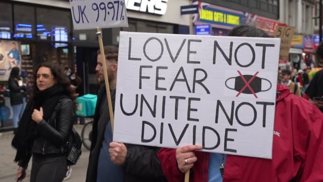 protest banners a waved as protesters show a lack of social distancing during a unite for freedom march on october 24, 2020 in london, england.... - sign stock videos & royalty-free footage