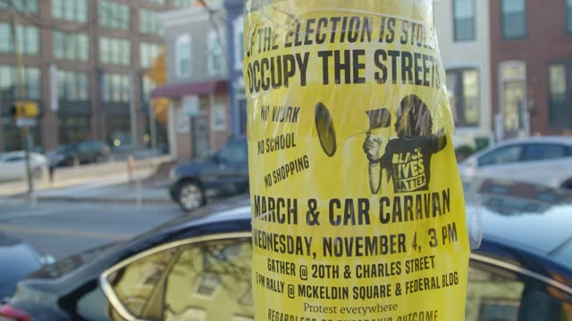 protest flier is posted on a light pole on november 28 in baltimore, maryland. covid-19 cases are expected to surge after holiday travel from the... - thanksgiving politics stock videos & royalty-free footage