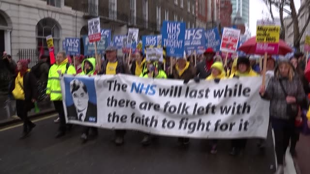 London Bloomsbury EXT Protesters gathered by UCL / Various of people taking part in march in support of the NHS Jon Ashworth MP interview SOT
