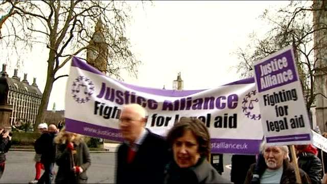 protest march and rally against legal aid cuts england london westminster ext crowd of protesters / effigy of chris grayling mp being held up **music... - legal system stock videos & royalty-free footage