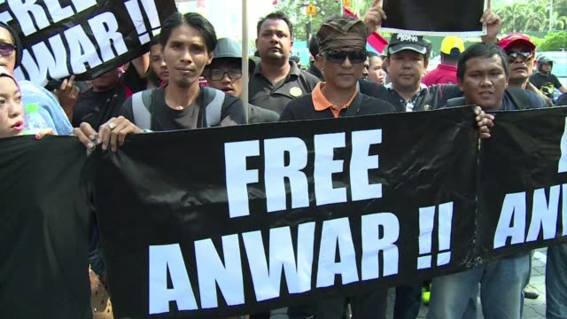 A protest march takes place in Kuala Lumpur demanding the release of jailed Malaysian opposition leader Anwar Ibrahim