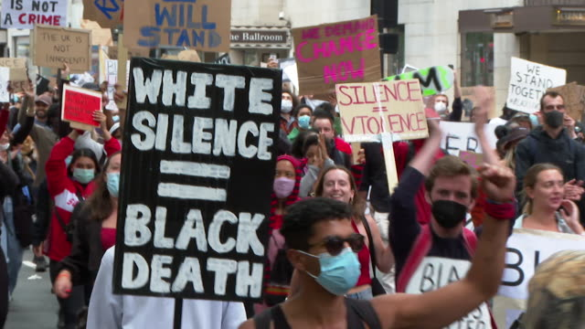 protest march through london over the death of george floyd an africanamerican who was killed when a policeman knelt on his neck whilst being... - north america stock videos & royalty-free footage