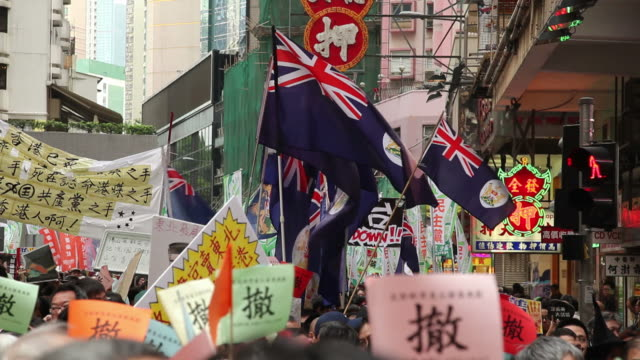 ws protest march with colonial flags / hong kong, china - government stock videos & royalty-free footage