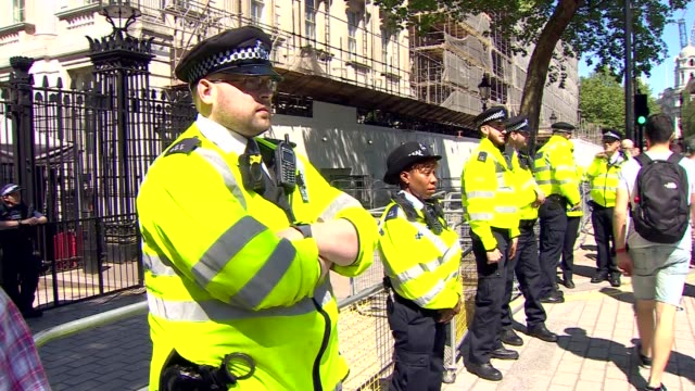 Protest outside Downing Street ahead of visit by Recep Tayyip Erdogan ENGLAND London Whitehall EXT Wide shot of protesters / police officers outside...