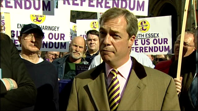 Protest outside Houses of Parliament calling for EU referendum general views / photocall / Nigel Farage interview Farage interview SOT On number of...