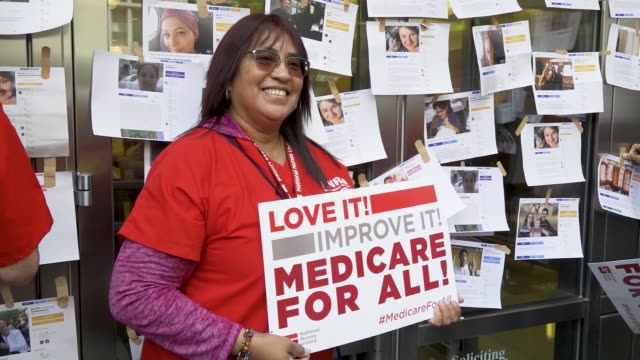 protest outside of the pharmaceutical research and manufacturers of american headquarters on april 29, 2019 in washington dc. on tuesday april 30,... - medicare stock videos & royalty-free footage
