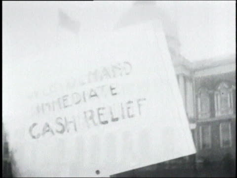 protest sign demanding immediate cash relief superimposed over capital building / washington d - 1932 stock-videos und b-roll-filmmaterial