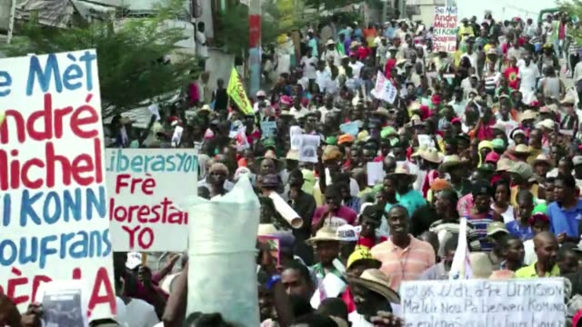 stockvideo's en b-roll-footage met a protest took place again in port au prince to ask haiti president michel martelly to resign - hispaniola