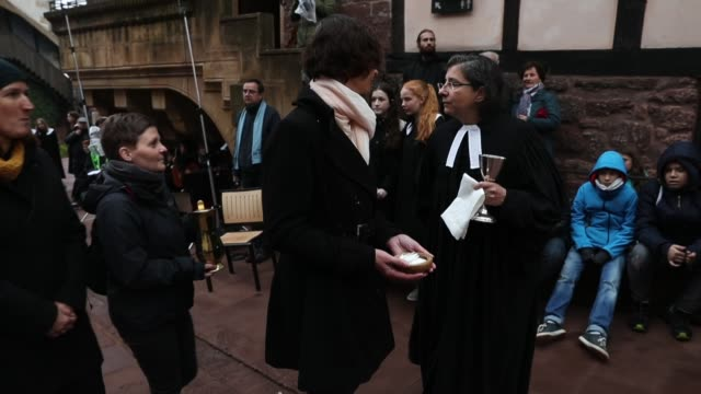 protestant clergy members return after administering the eucharist during an openair religious service at wartburg castle to commemorate the may 4... - martin luther religious leader stock videos & royalty-free footage