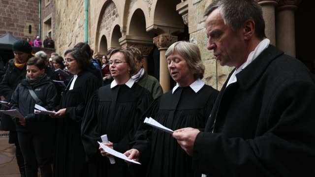 protestant clergy members sing during an openair religious service at wartburg castle to commemorate the may 4 arrival of martin luther on may 4 2017... - martin luther religious leader stock videos & royalty-free footage