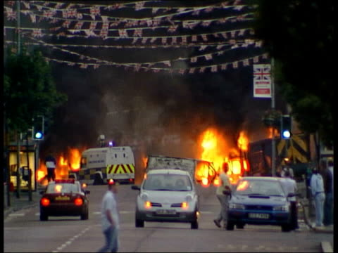 protestant demonstrators clash with police in belfast large fire burning across road - protestantism stock videos & royalty-free footage
