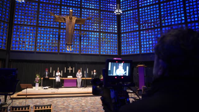 protestant theologian ulrike trautwein prepares for a an interfaith church service at the kaiser wilhelm memorial church that was to be broadcast... - プロテスタント点の映像素材/bロール