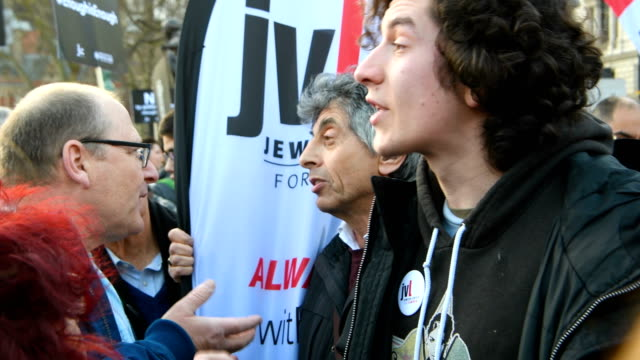 A protester and counterprotester have a heated discussion as they attend a demonstration in Parliament Square against antisemitism in the Labour...