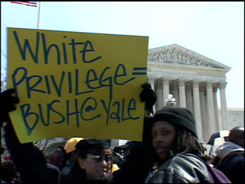Protester carrying a 'White Privilege = Bush at Yale' sign