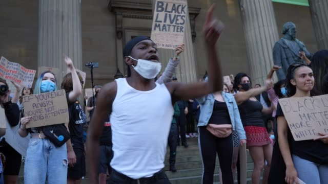 protester chants to the crowd as people gather for a 'black lives matter' solidarity demonstration outside st george's hall on june 02, 2020 in... - liverpool england stock videos & royalty-free footage