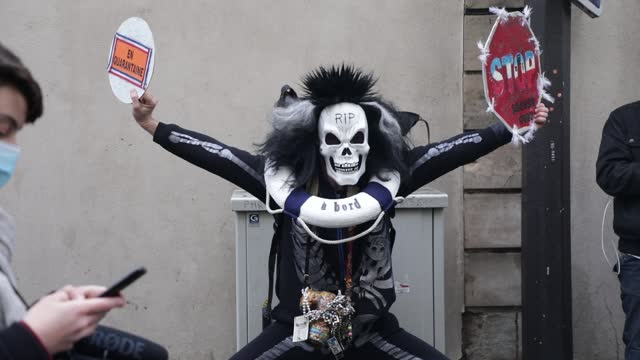 protester dressed as a skeleton poses during a demonstration against the plans of tour operator tui and unions on january 23, 2021 in paris, france.... - protestor stock videos & royalty-free footage