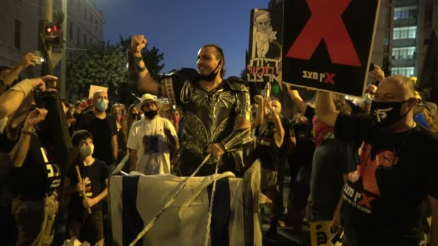 protester dressed as an ancient roman emperor giving a satirical speech as over ten thousand people gathered for a demonstration against prime... - satira video stock e b–roll