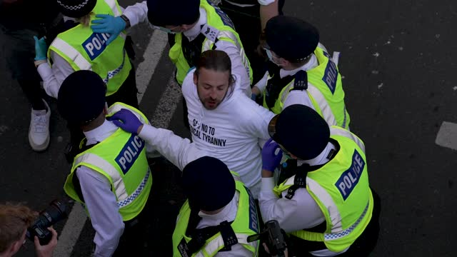 """protester get arrested as protesters march during a """"unite for freedom"""" anti-lockdown demonstration held to protest against the use of vaccine... - slow motion stock videos & royalty-free footage"""