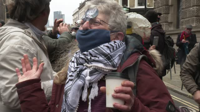 protester has a julian assange sticker on her forehead outside the old bailey on january 04, 2021 in london, england. district judge vanessa... - label stock videos & royalty-free footage