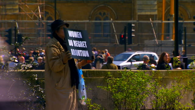 protester holding sign women do regret abortion - abortion stock videos and b-roll footage