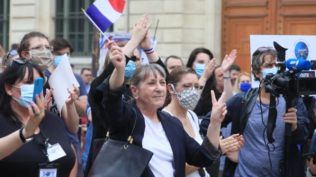 a protester holds a french flag during the collective ffoc rally in support of the police force on june 27 2020 in paris france the slogan used for... - femininity stock videos & royalty-free footage
