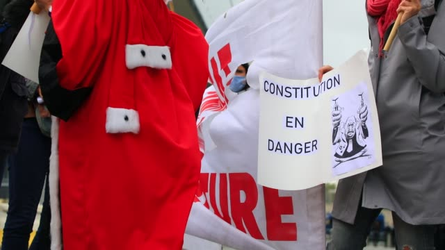 """protester holds a sign that reads """"constitution in danger"""" during a demonstration called by the two main magistrates unions, the union syndicale de... - supreme court justice stock videos & royalty-free footage"""
