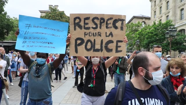 a protester holds a sign that says respect for the police during the collective ffoc rally in support of the police force on june 27 2020 in paris... - femininity stock videos & royalty-free footage
