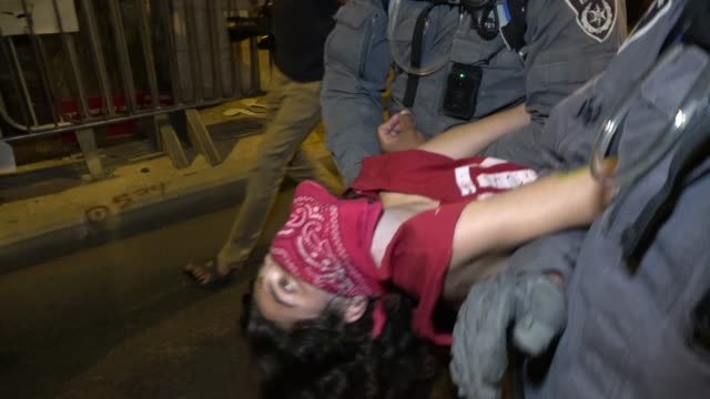 """protester is dragged away by police as he shouts """"we will not give up until bibi resigns"""" during a mass demonstration near prime minister's official... - protestor stock videos & royalty-free footage"""